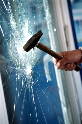 testing safety window film with a sledge hammer