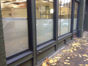 Privacy window film is installed on the windows of a commercial building.